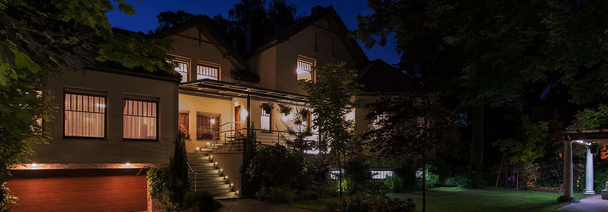 family home lit up at night